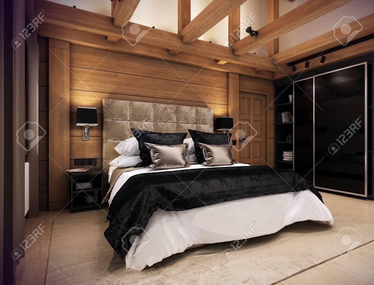 Das Gemütliche Schlafzimmer Befindet Sich Im Dachgeschoss Eines ...