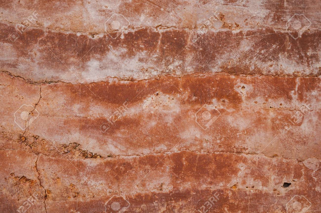 Different Shades Of Orange rammed earth wall texture with different shades of orange soil