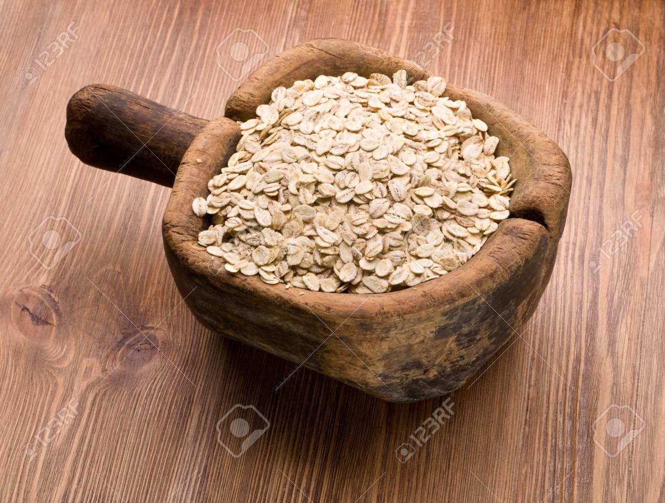 oat flakes on wood background Stock Photo - 17957934