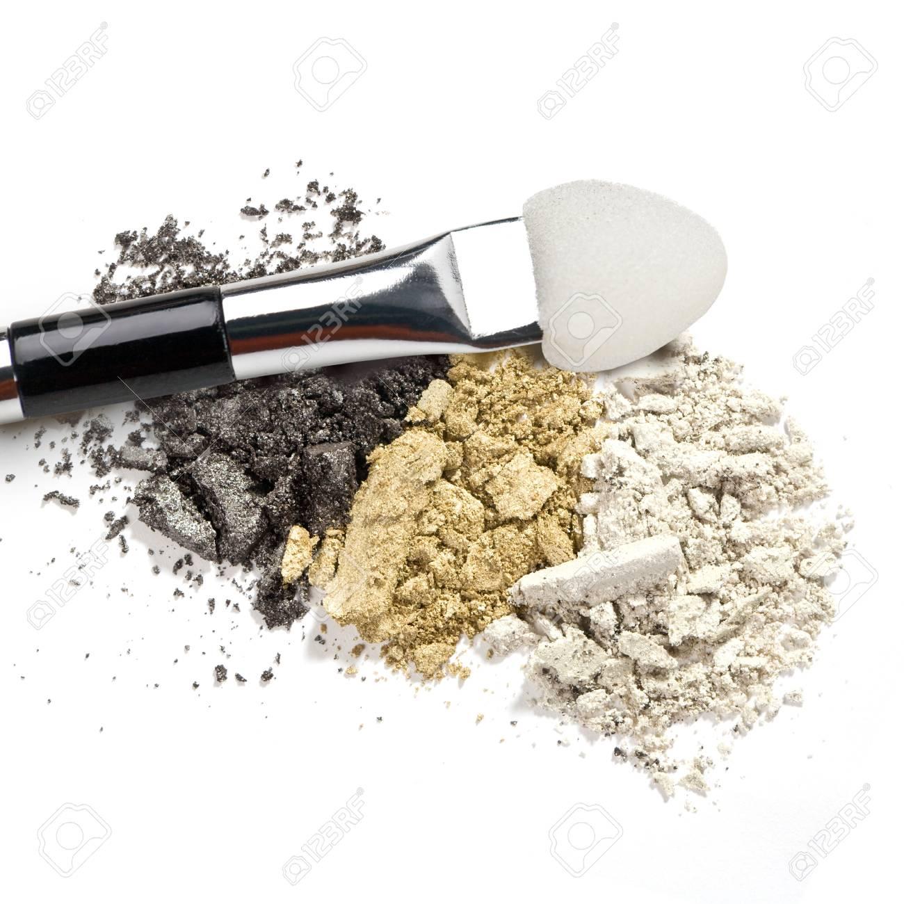 Make-up brush with colorful crushed eyeshadows Stock Photo - 19491478