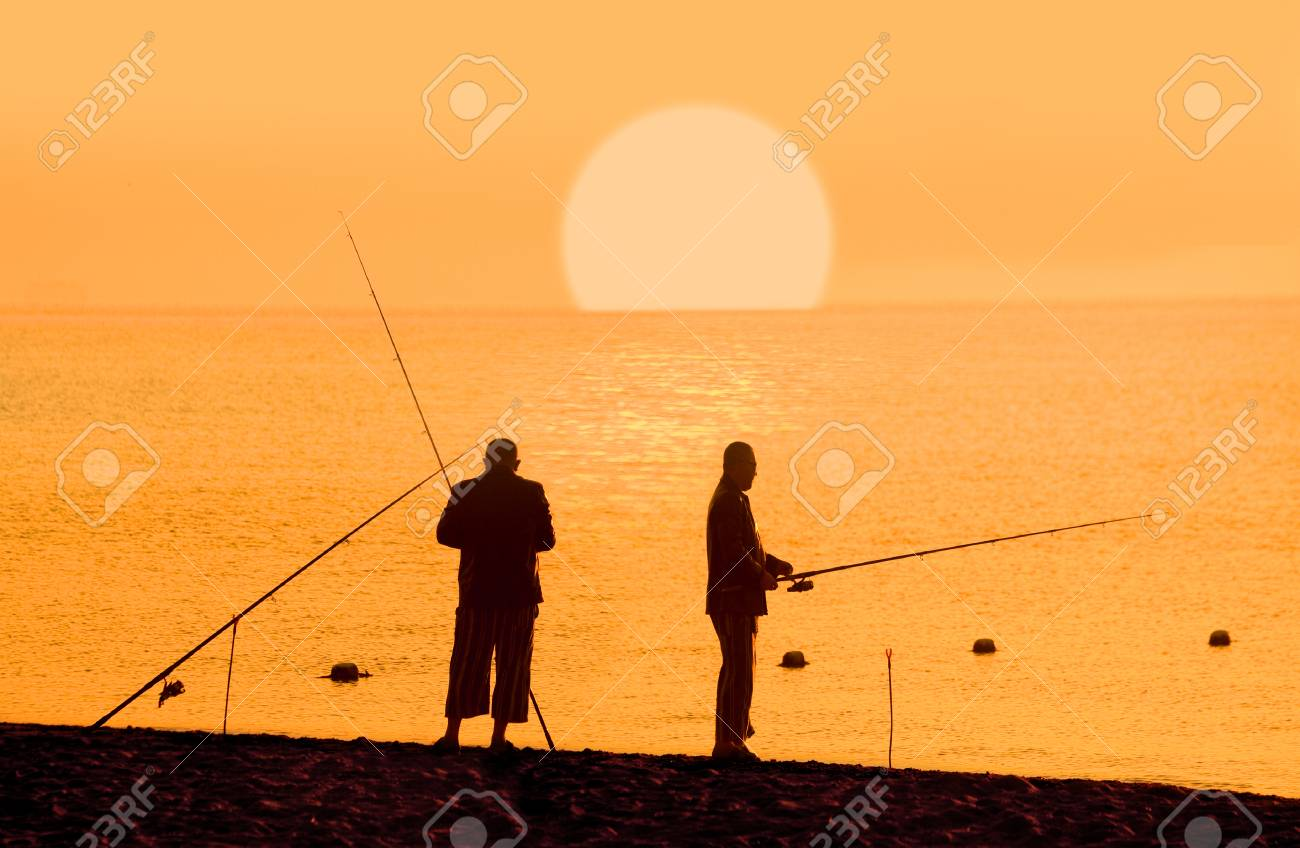 Fishermans silhouette at sunrise Stock Photo - 23575618