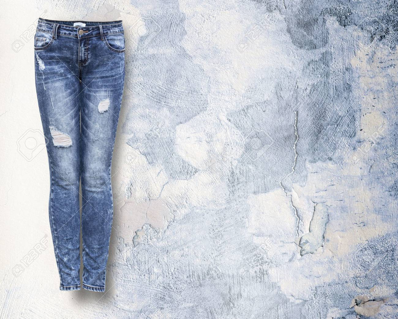 woman jeans in light light grunje background with copy space - 47856366