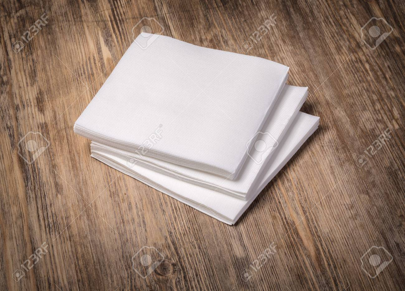 white paper napkin on old wooden table - 65356440