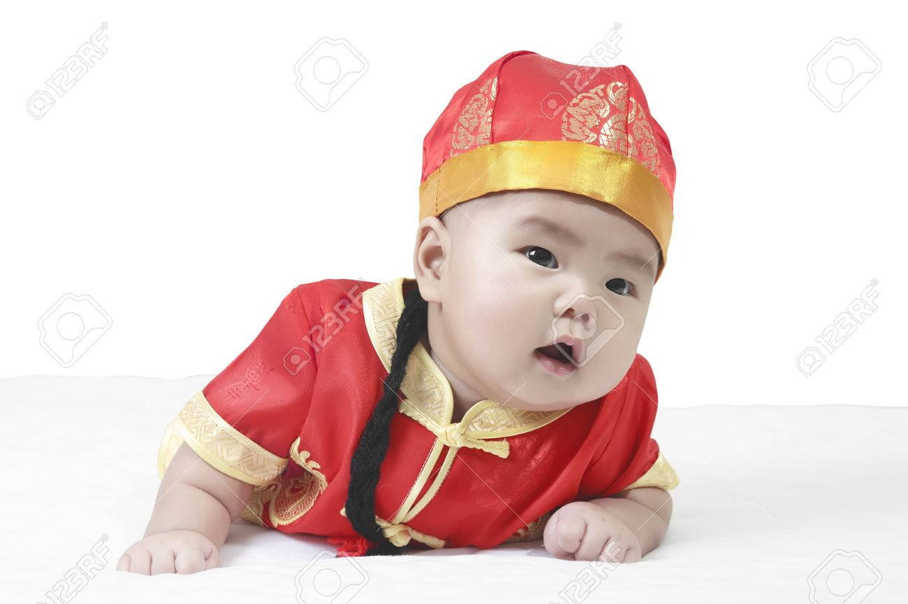 Asian cheerful and wonder baby boy wearing red Chinese suit or clothes with  hat crawl on eac4f126ed3