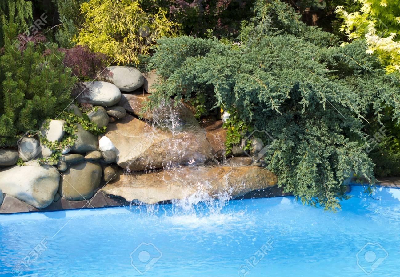 Swimming Pool water fall Stock Photo - 17635094