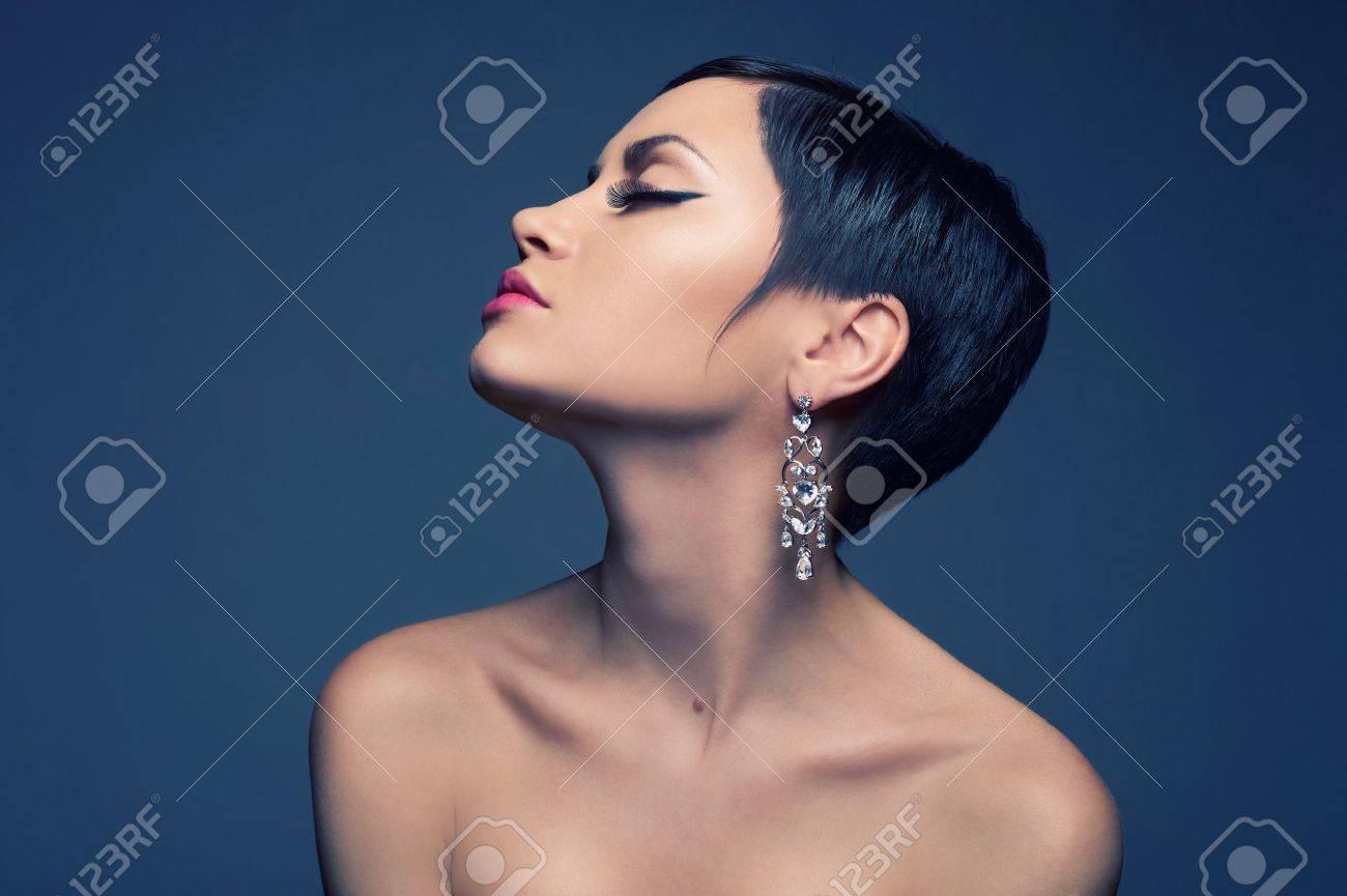 Sensual portrait of a beautiful lady with diamond earring Stock Photo - 11990662
