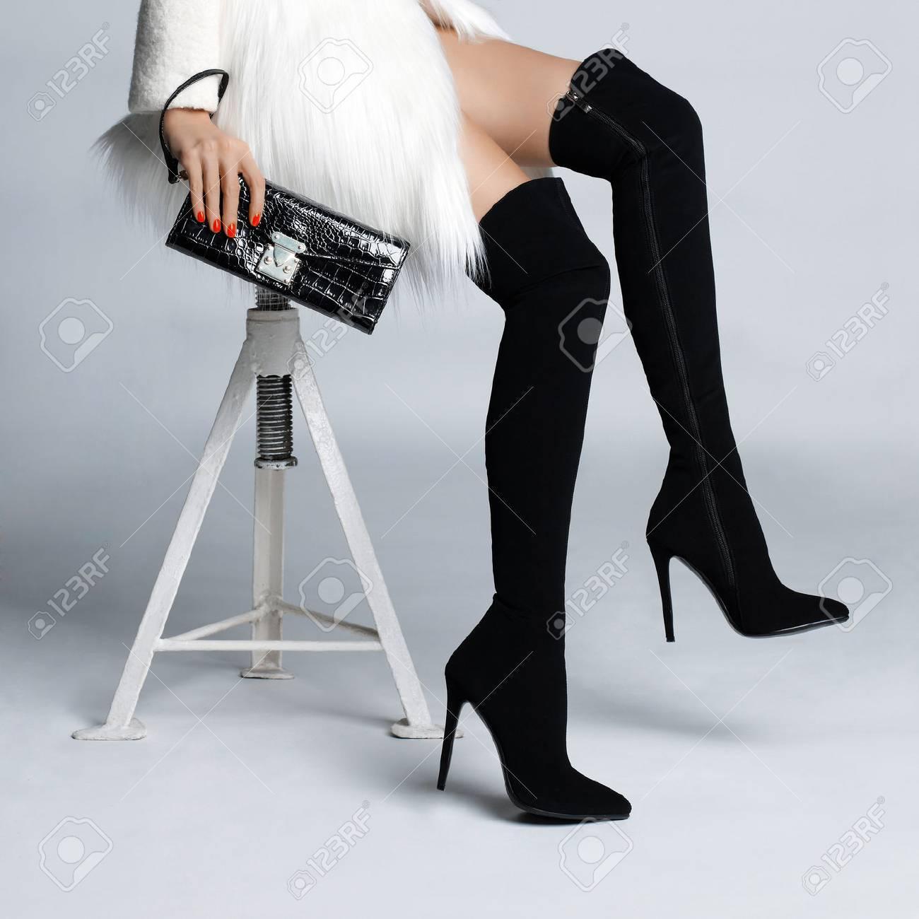 femme avec des bas et bottes
