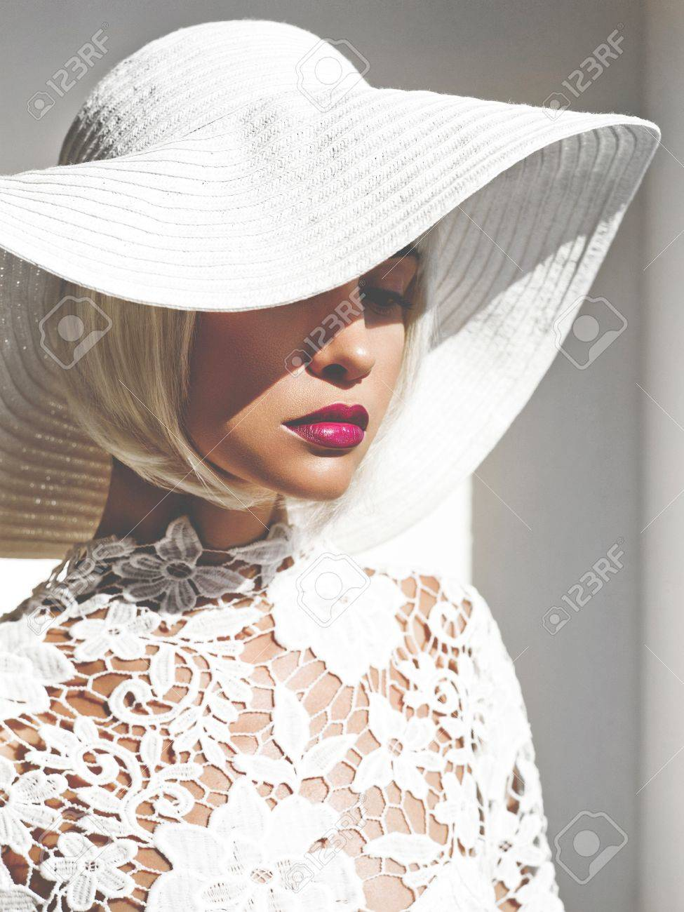 Outdoor fashion photo of young beautiful lady in white hat. Summer Beach  travel. Summer 3a06ad107f4