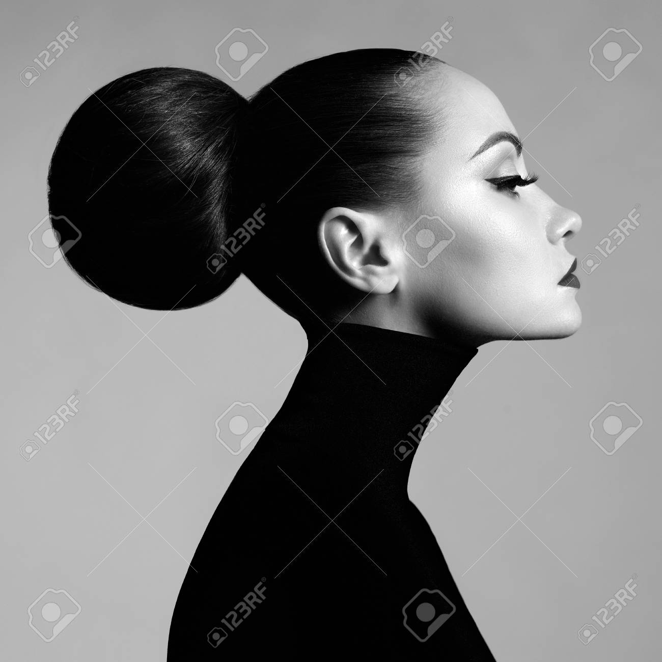 Black and white fashion art studio portrait of beautiful elegant woman in black turtleneck hair