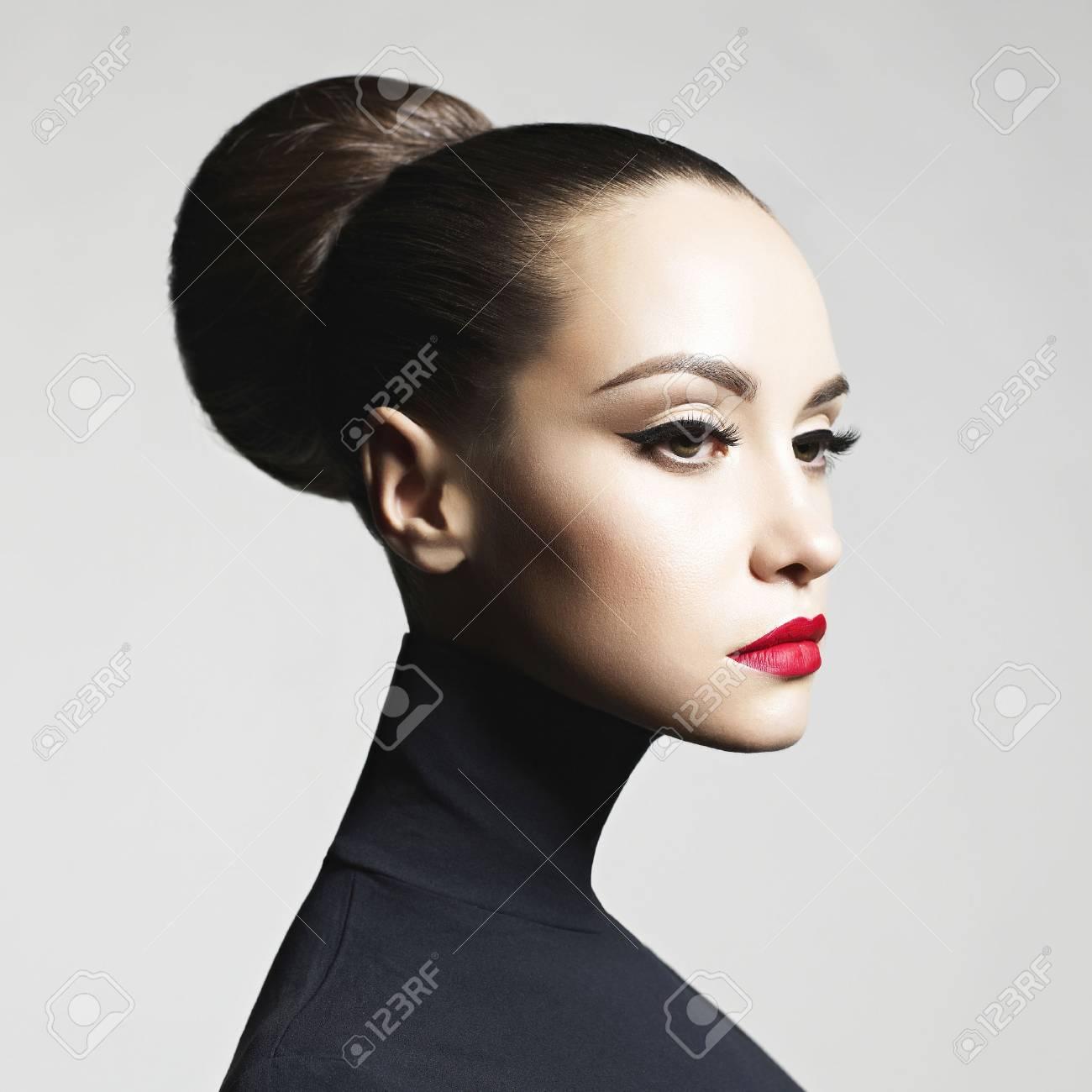 Fashion art studio portrait of beautiful elegant woman in black turtleneck. Hair is collected in high beam. Elegant ballet style - 91087166