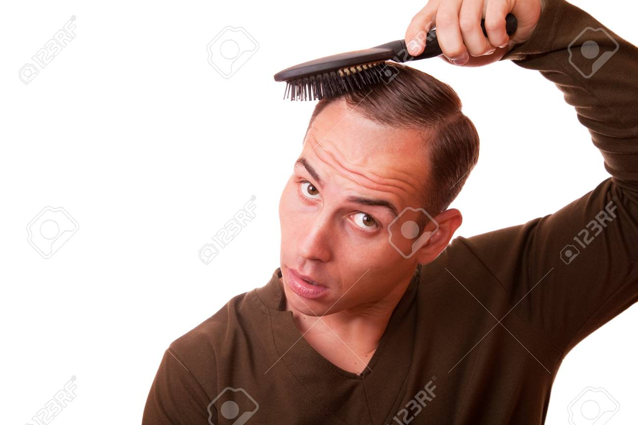 Young Man Combing The Hair Of A White Background