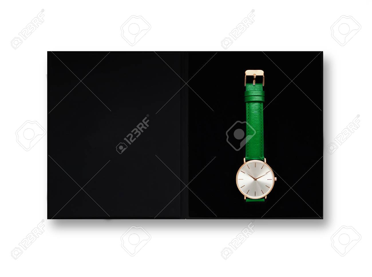 Classic women's gold watch with white dial, green leather strap, isolate on a white background. View from the top in the box. - 121016304