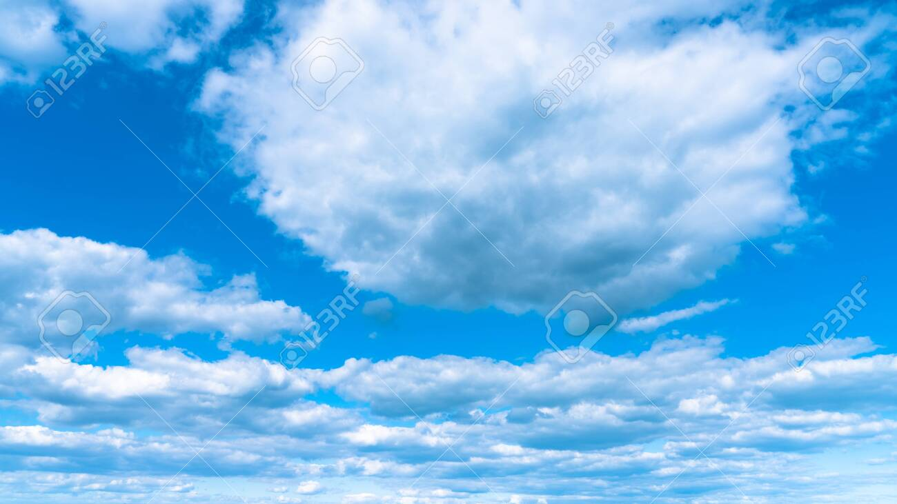 Landscape white clouds on a blue sky, atmospheric weather phenomenon, natural chaotic forms created by nature. - 151152258
