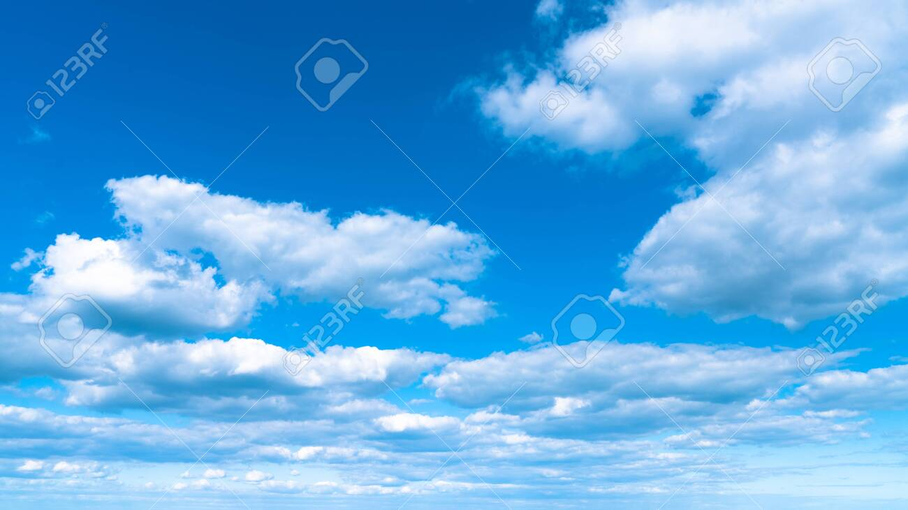 Landscape white clouds on a blue sky, atmospheric weather phenomenon, natural chaotic forms created by nature. - 151152263