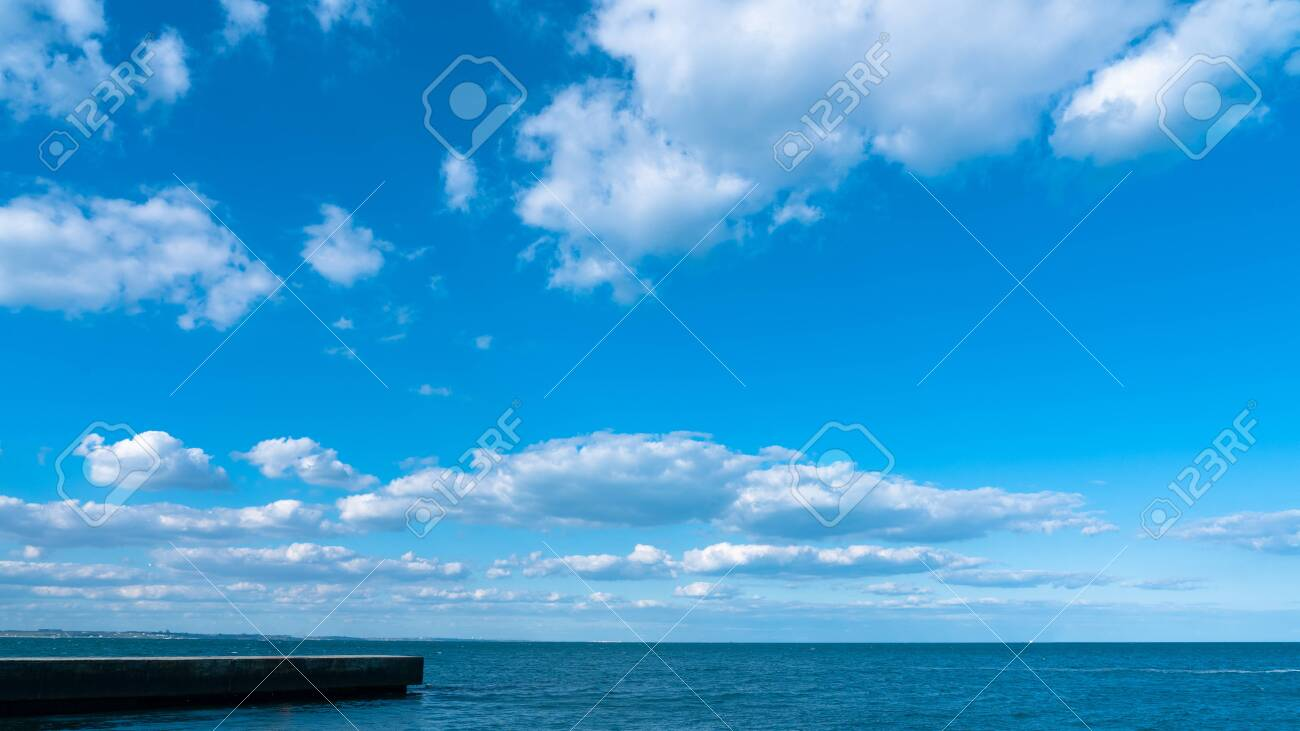 Landscape white clouds on a blue sky, atmospheric weather phenomenon, natural chaotic forms created by nature. - 151152161