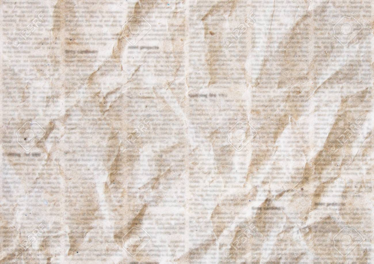 old crumpled grunge newspaper paper texture background. blurred