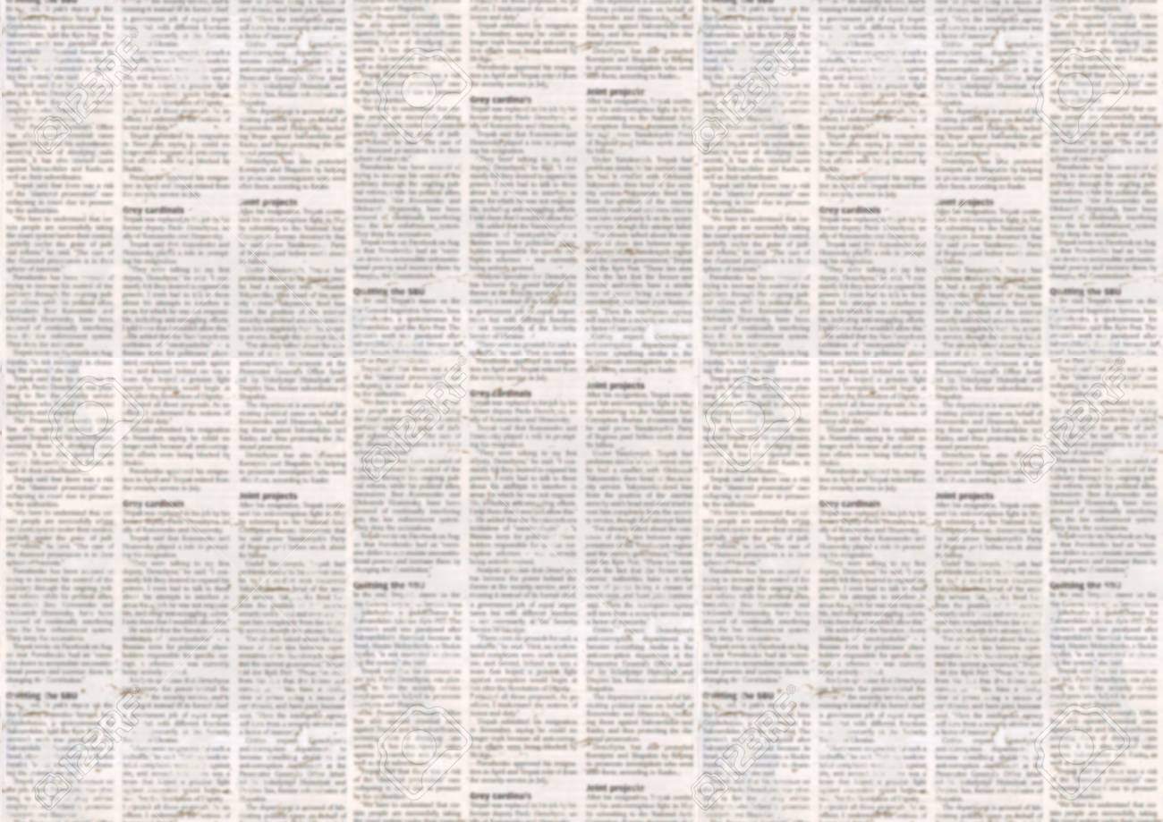 old newspaper paper texture background. blurred vintage newspaper