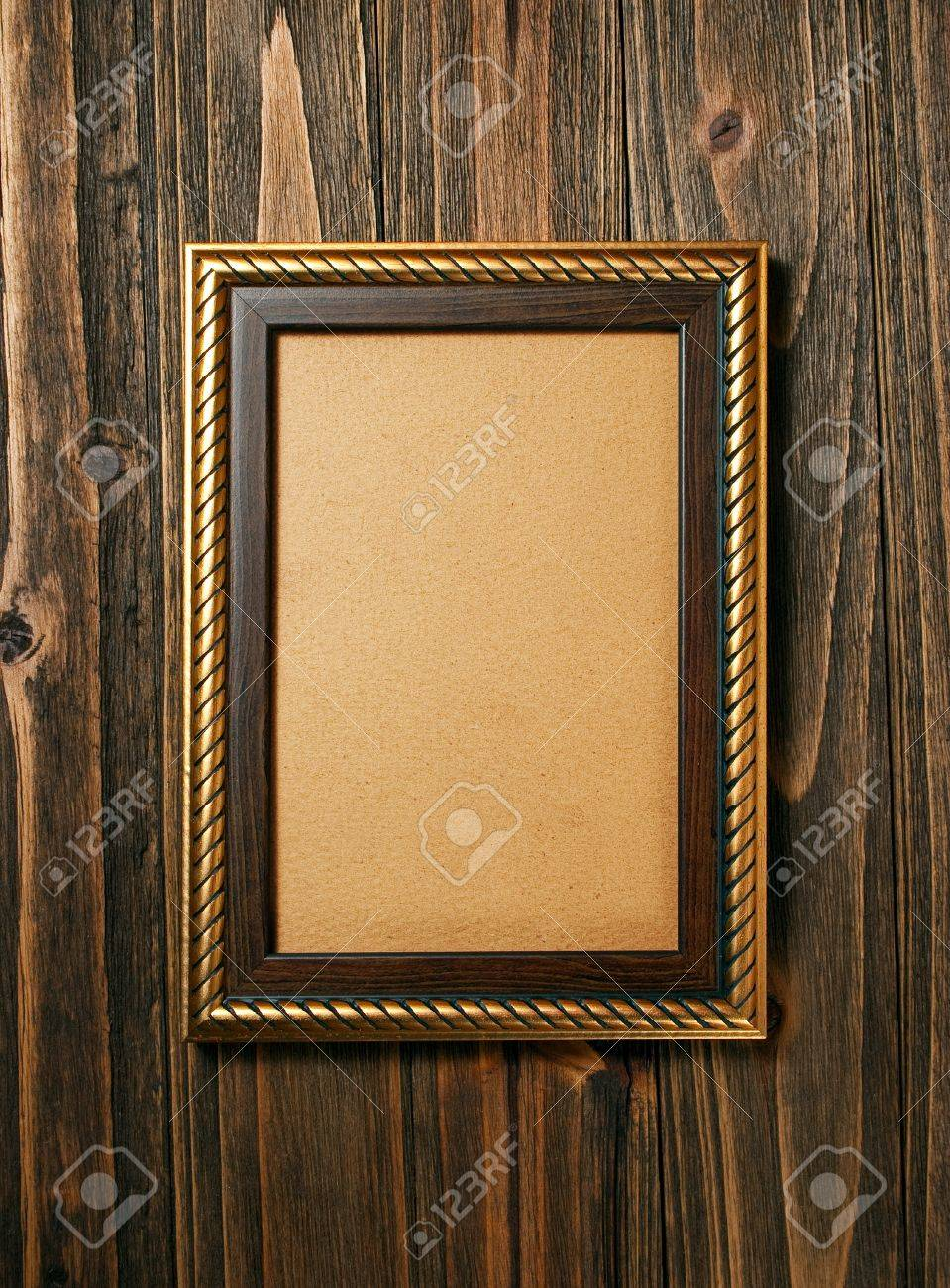 ancient style golden photo image frame on wood background Stock Photo - 12464664