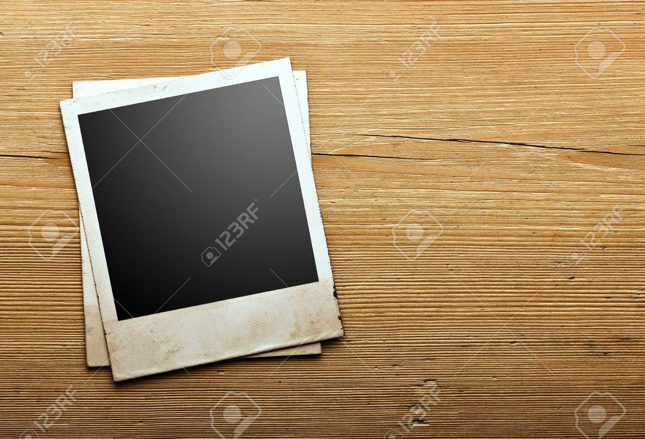 Old photo paper on vintage wood background Stock Photo - 15805073