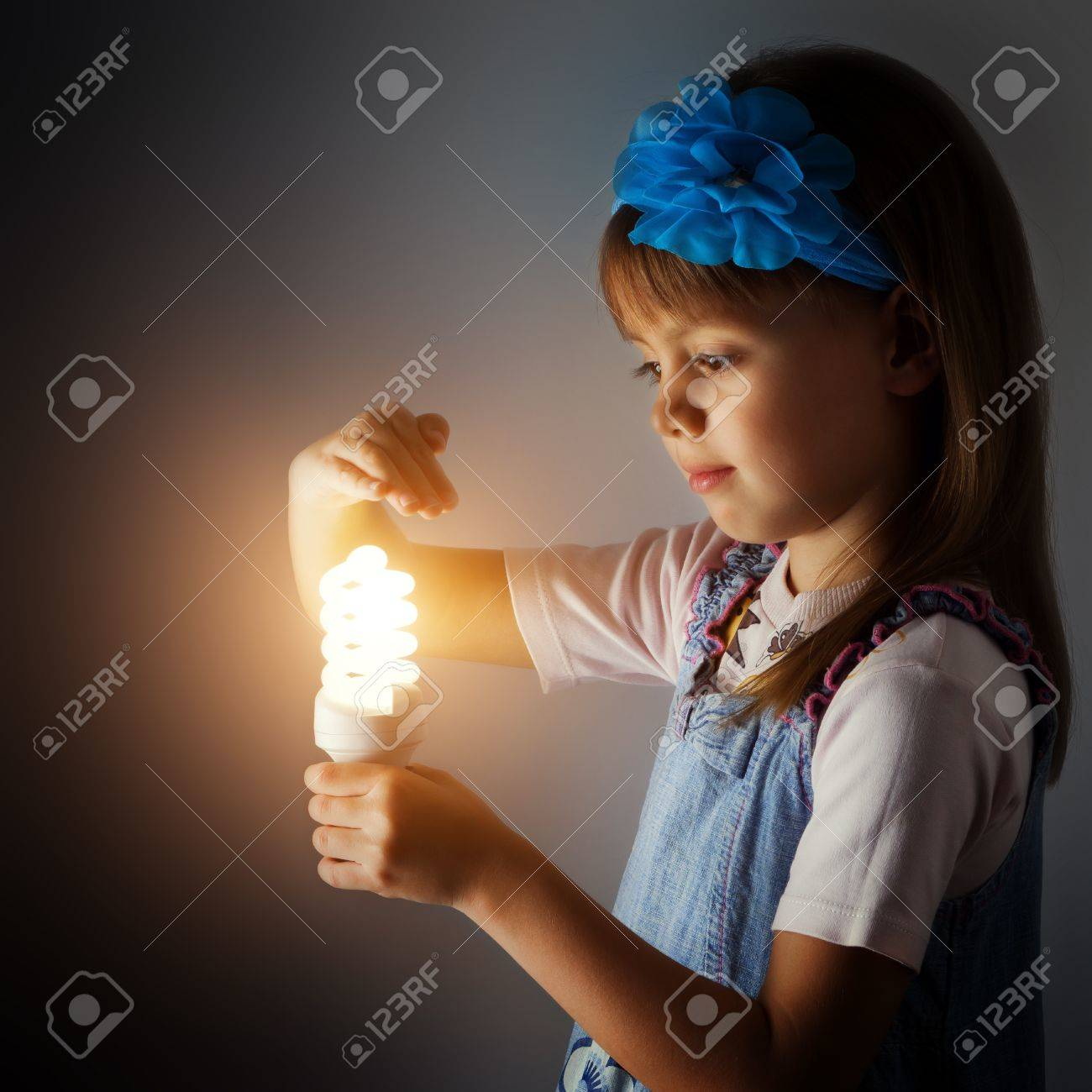 Little Girl With A Lit Lamp In Hand Stock Photo, Picture And ... for Little Girl With Lamp  186ref