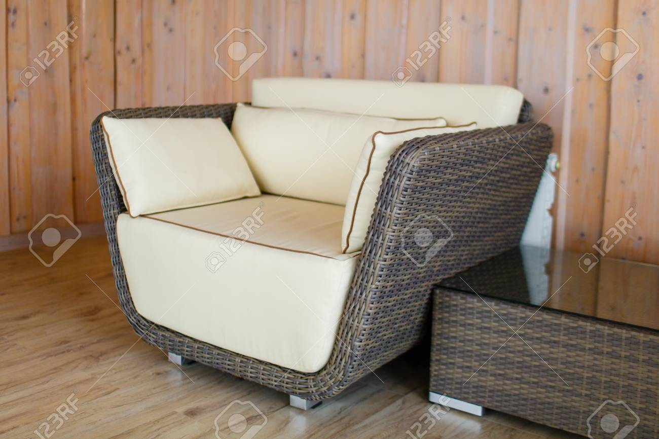 photo luxurious rattan wicker armchair next to coffee table