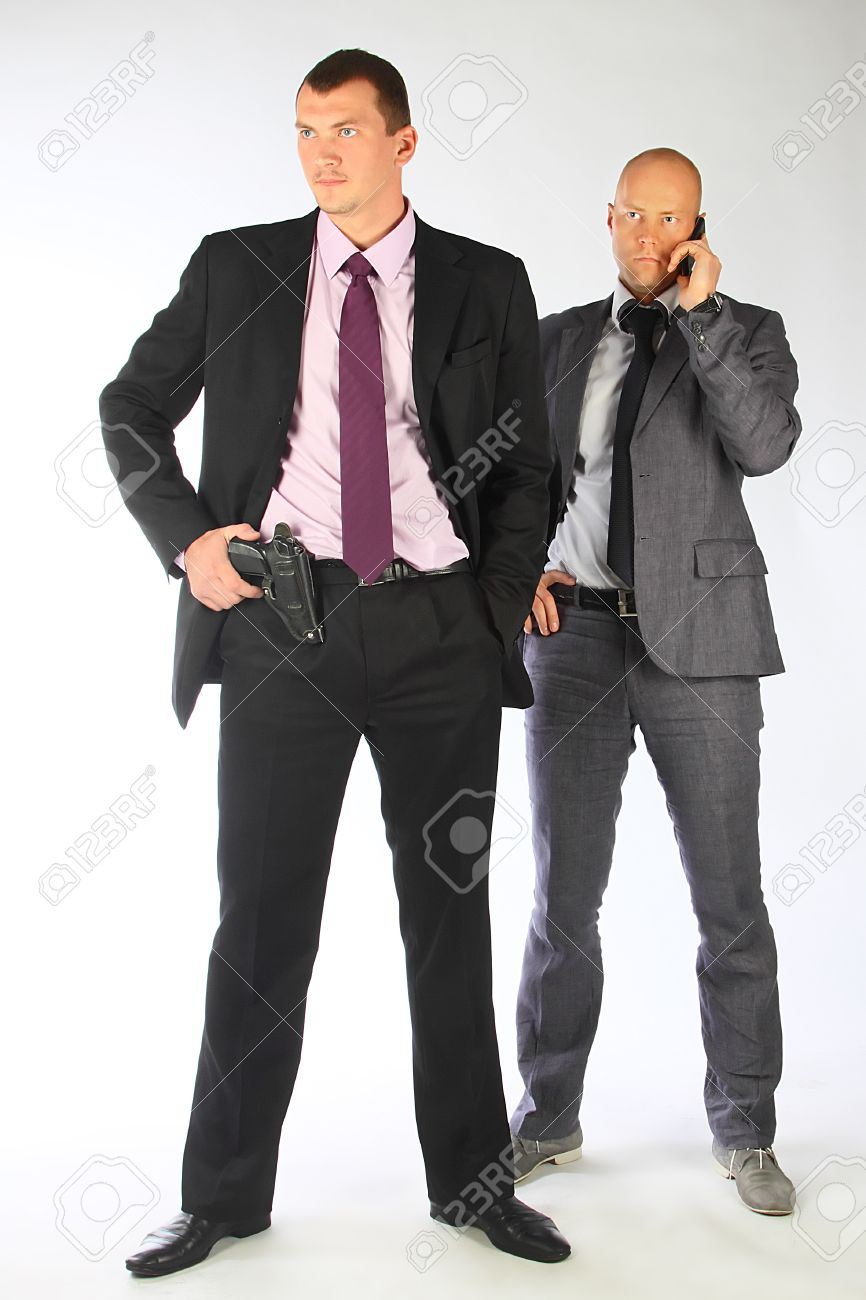 The businessman and the bodyguard with a pistol Stock Photo - 10724990