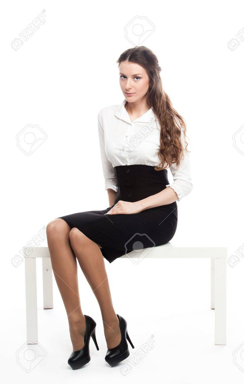 Portrait Of A Young And Beautiful Business Lady In A White Blouse