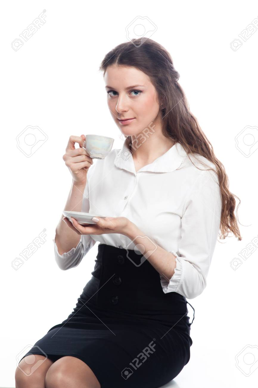 successful business woman drinking coffee from a white cup Stock Photo - 12598981