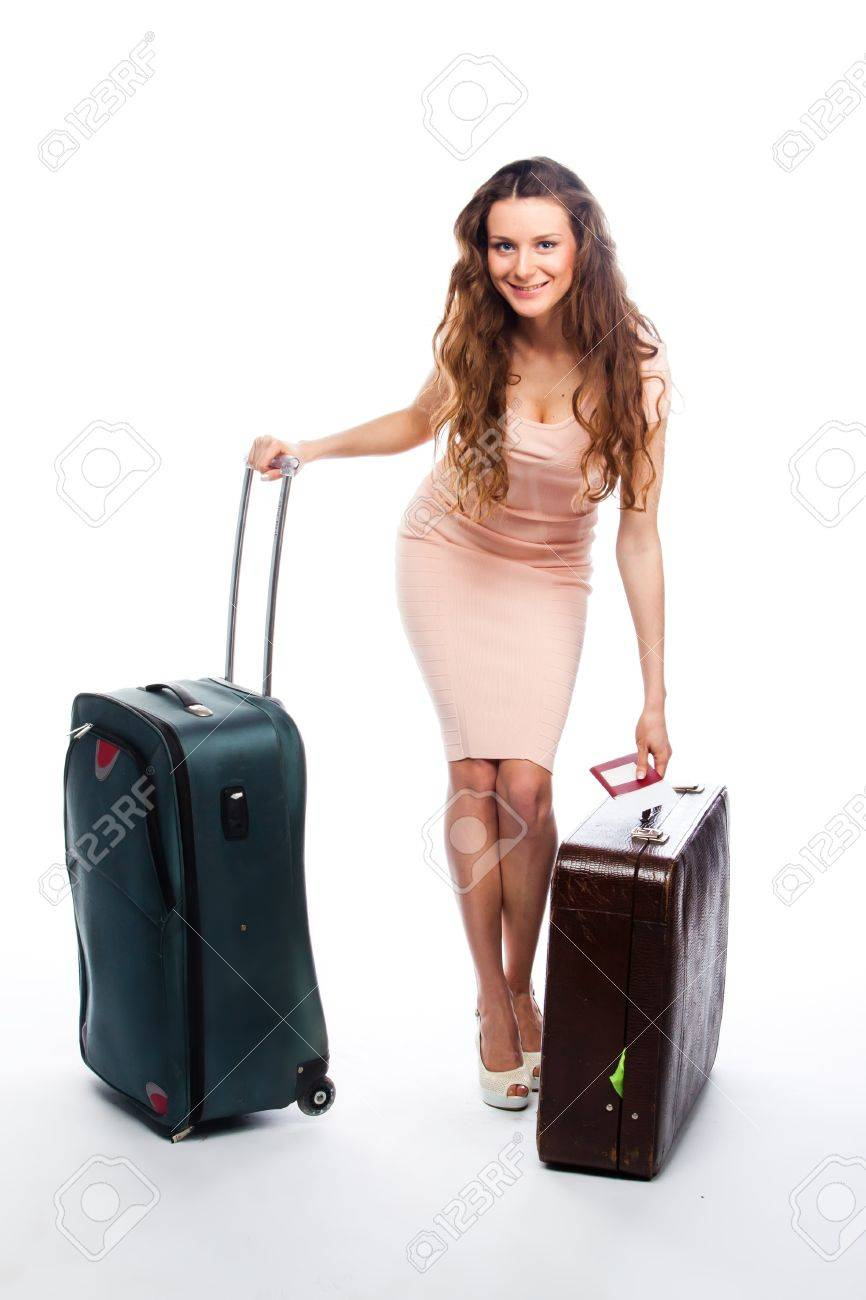 Photo of a young and beautiful girl with a suitcase, passport and ticket isolated on white background Stock Photo - 13831698