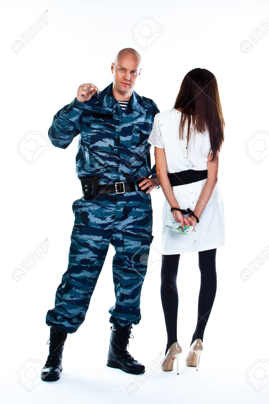 A police officer arrests a young woman Stock Photo - 16799970
