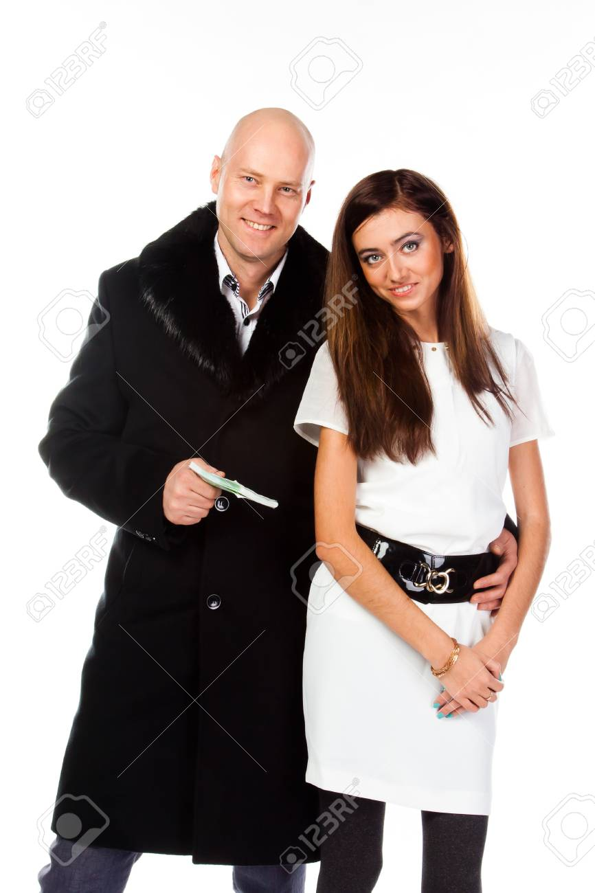 Business man with a beautiful young wife Stock Photo - 17008435