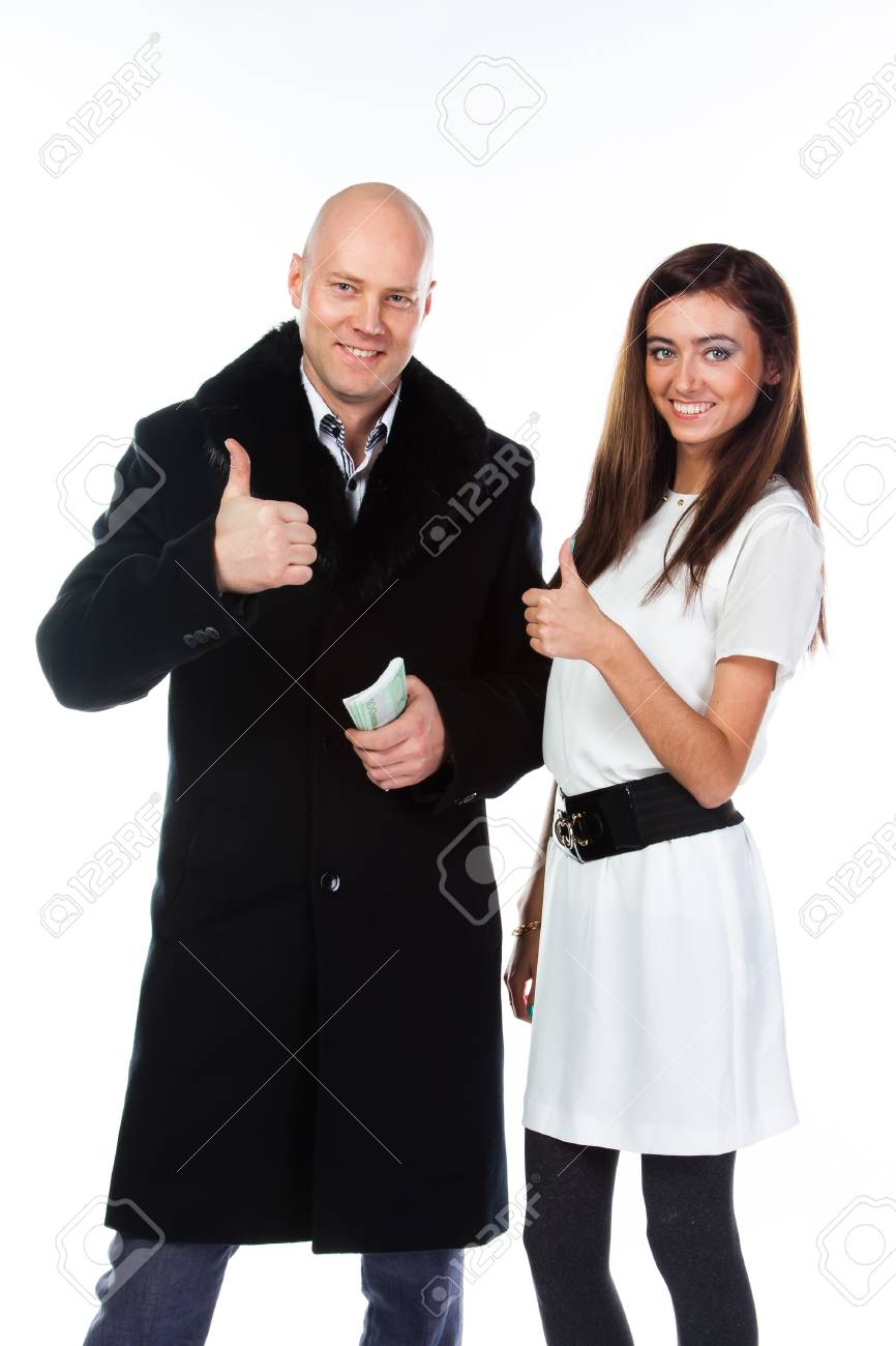 Business man with a beautiful young wife Stock Photo - 17008444