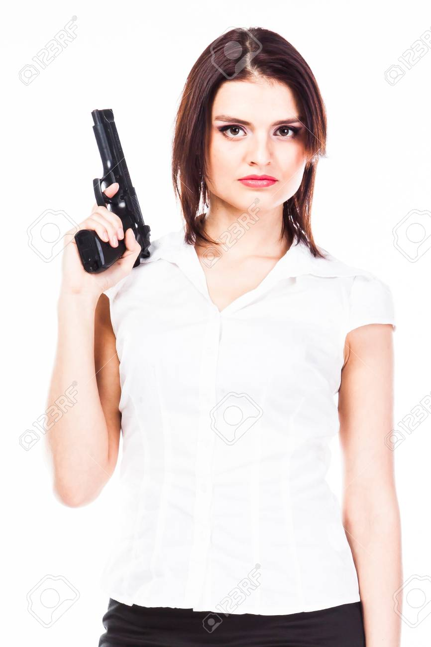 Young and beautiful woman with a gun Stock Photo - 17206320