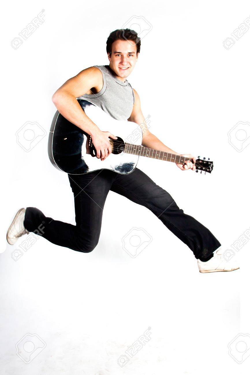 A young man in a jump with guitar Stock Photo - 17417442