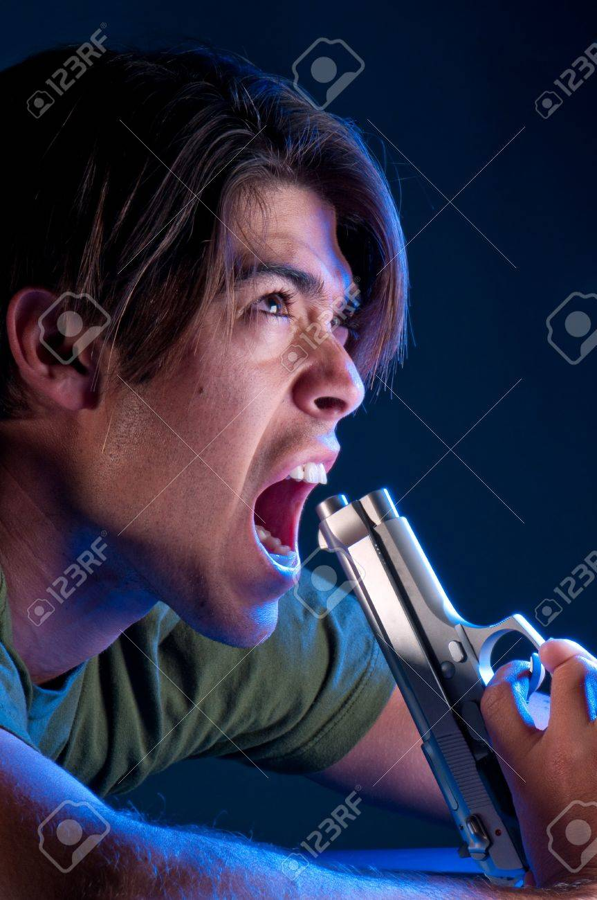 Young guy trying to commit suicide with an automatic gun. Stock Photo - 4536681