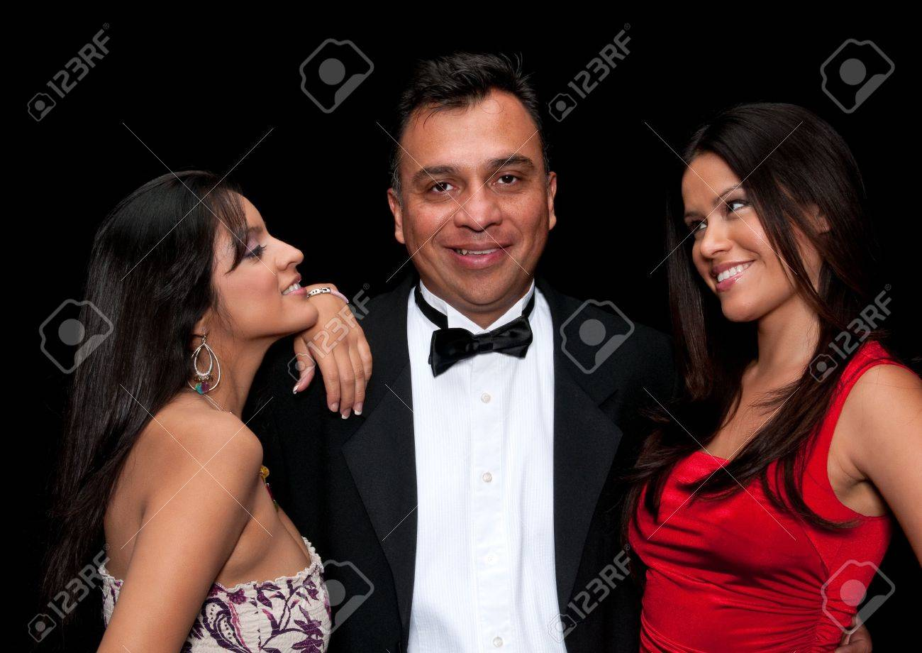 40 something executive with tuxedo flirting with young girls. Stock Photo - 5185254