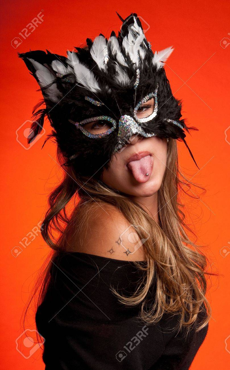 Young Caucasian Girl Wearing A Cat Mask. Stock Photo, Picture And ...
