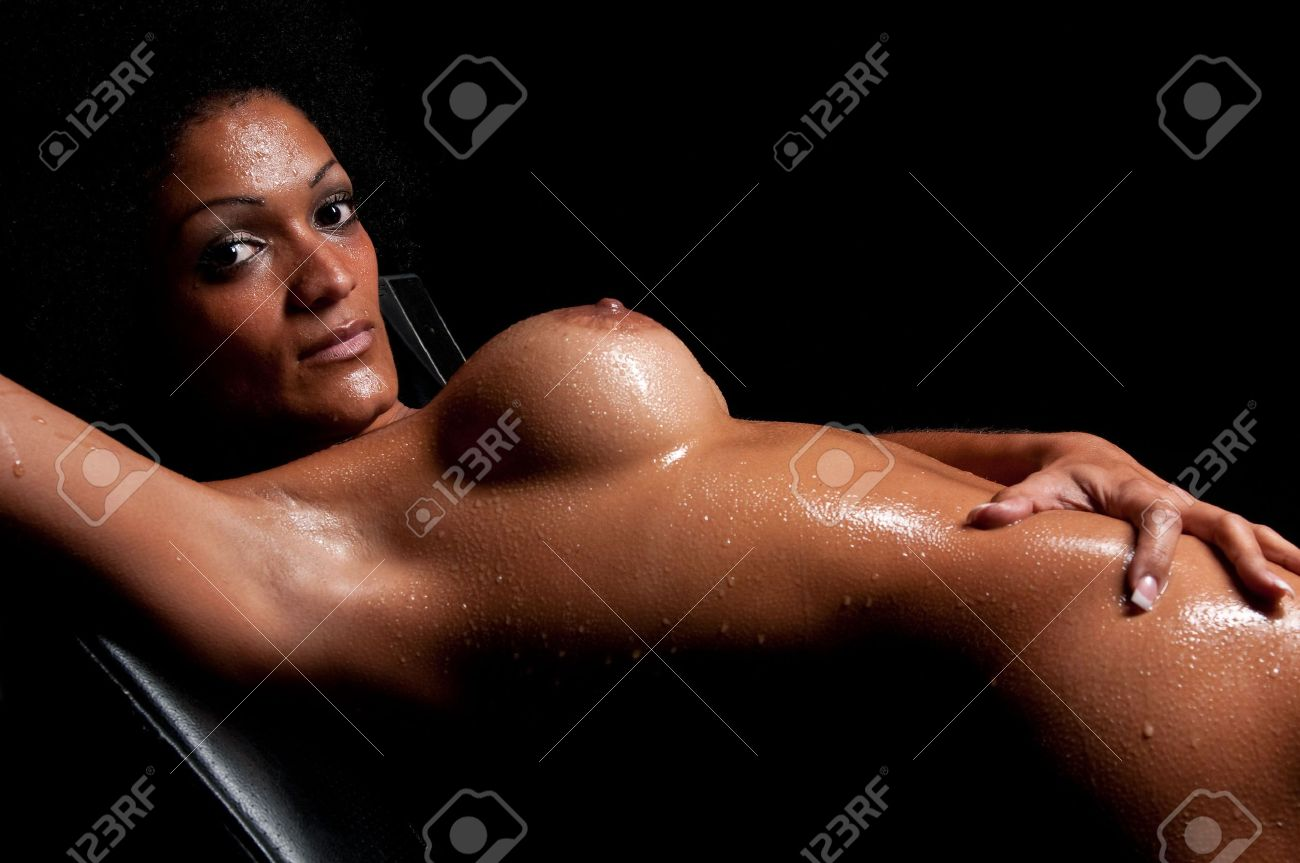 Young hispanic woman pasing nude and wet in dim light. Stock Photo - 5572509
