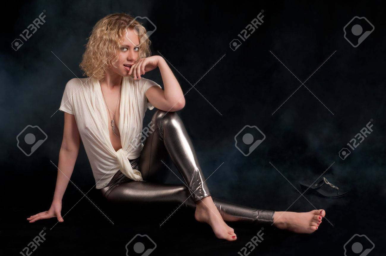Young caucasian woman with curly hair seated with sensual pose. Stock Photo - 6598087