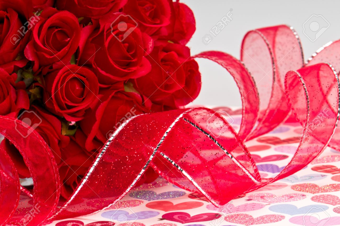 Close Up Of Red Roses And Red Ribbon For Valentines Day