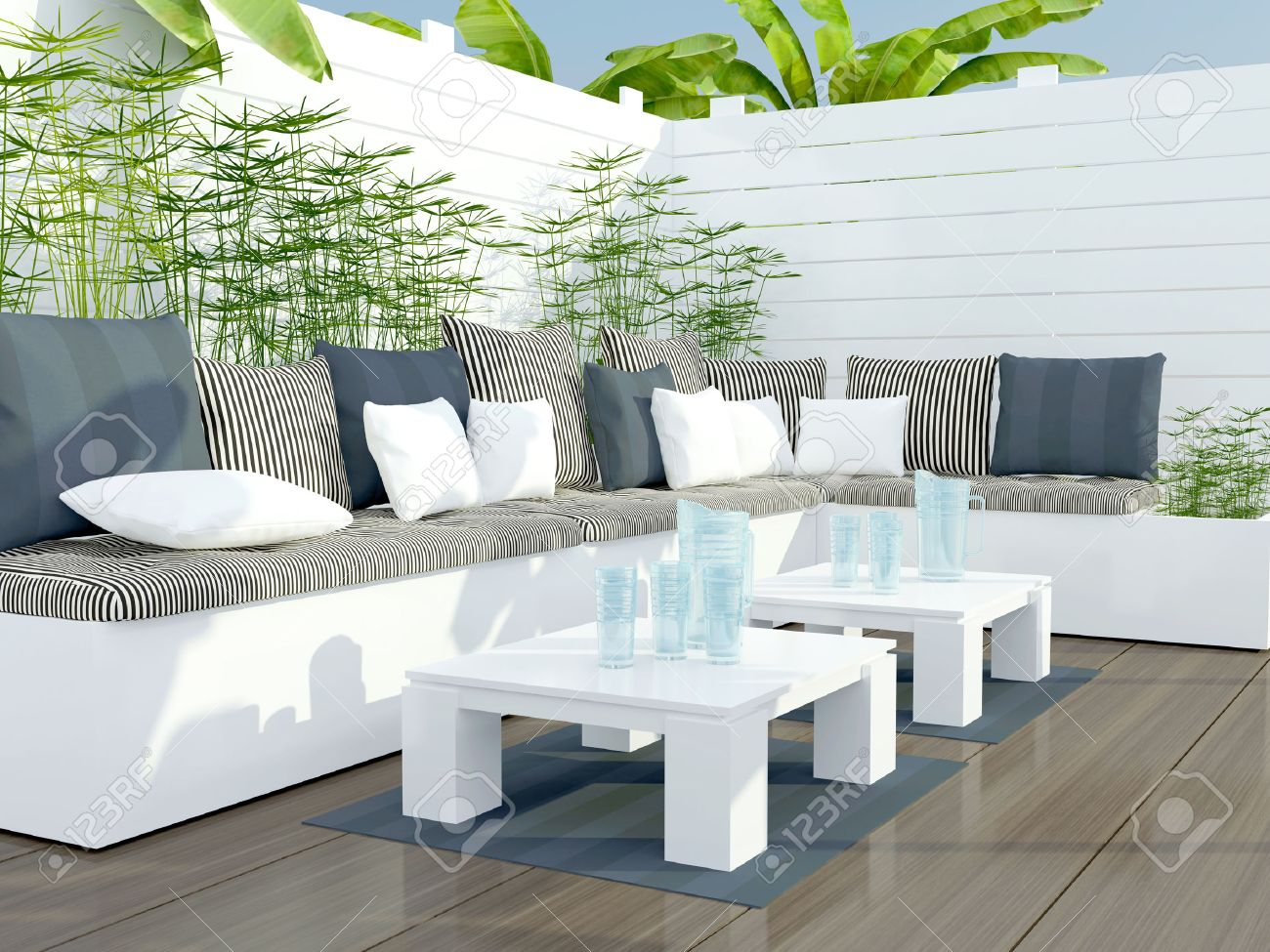 garden furniture outdoor patio seating area with big white sofa and table