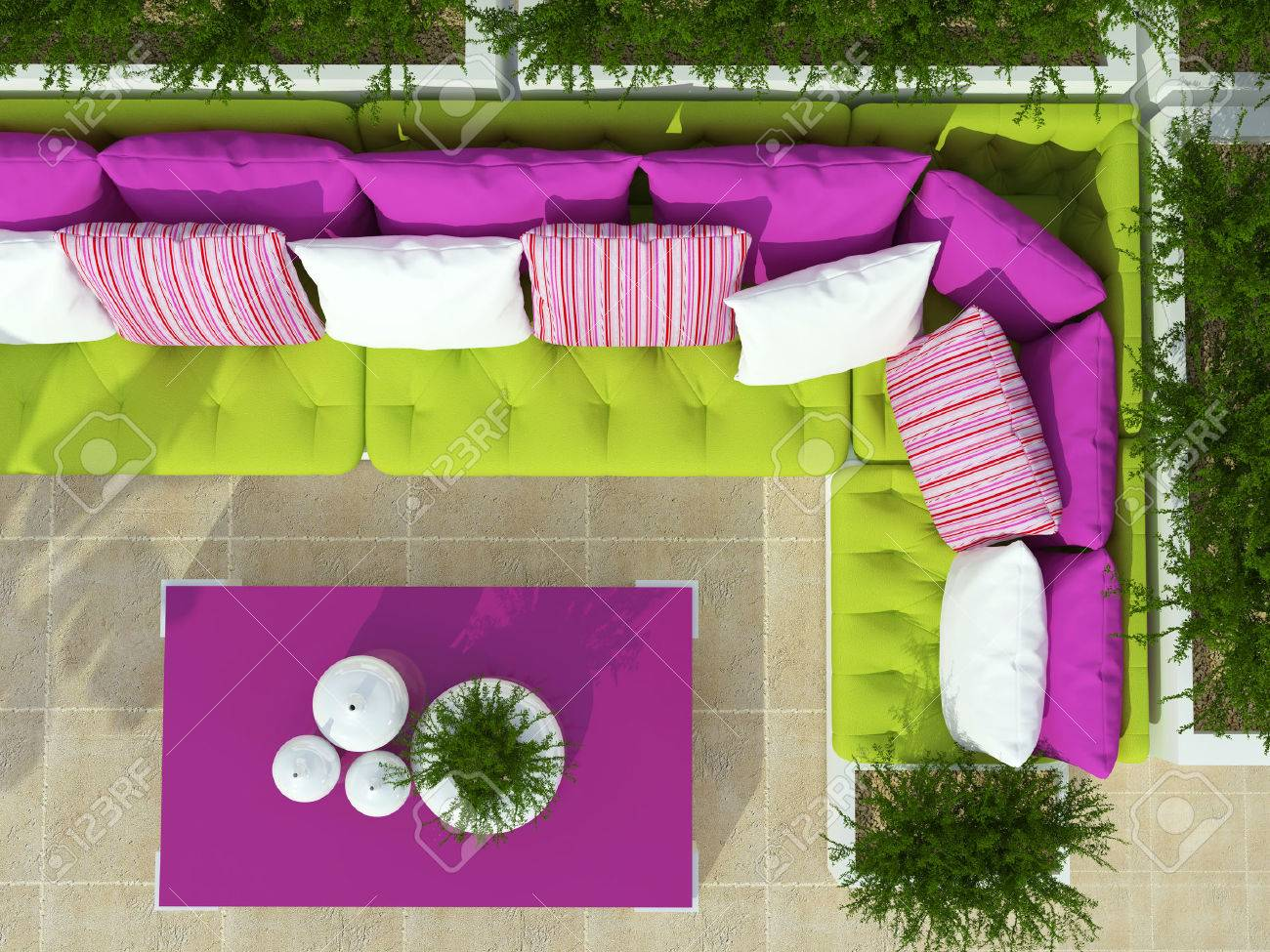 Outdoor Patio Seating Area With Big Green Sofa, Pink Table And Plants.  Stock Photo