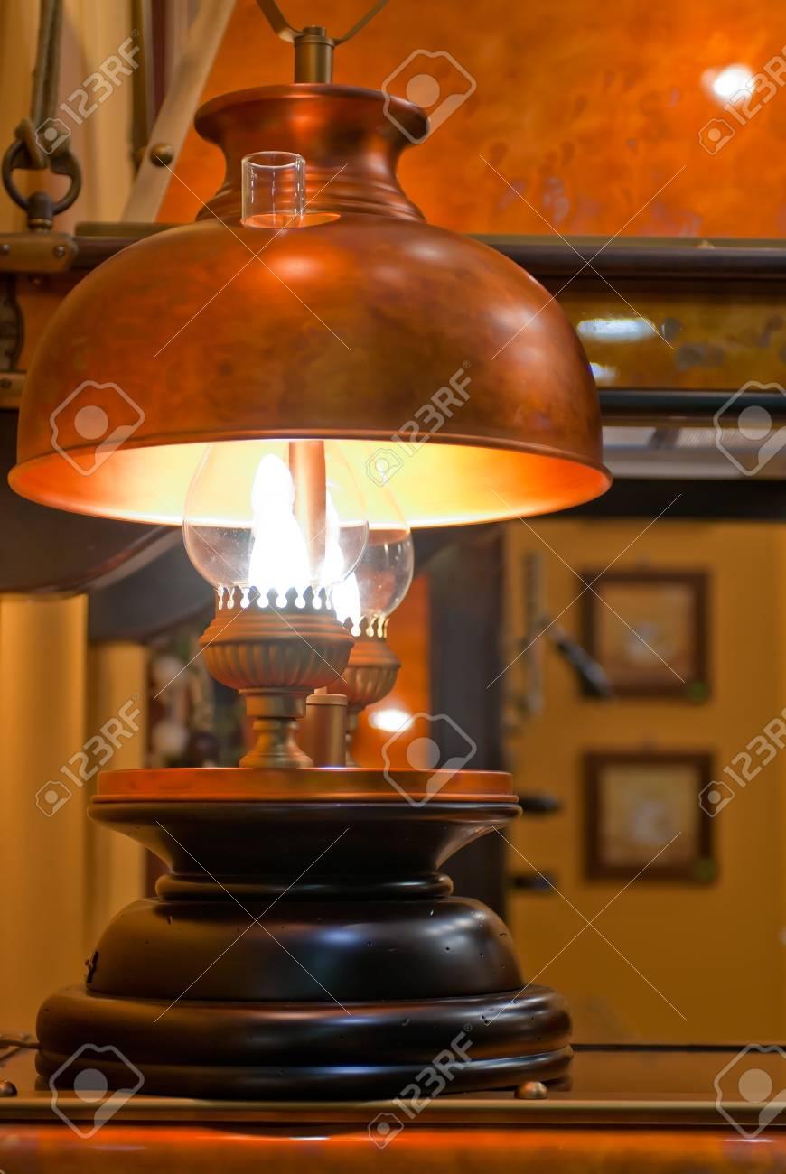 Old kerosene lamp with copper shade Stock Photo - 16468864