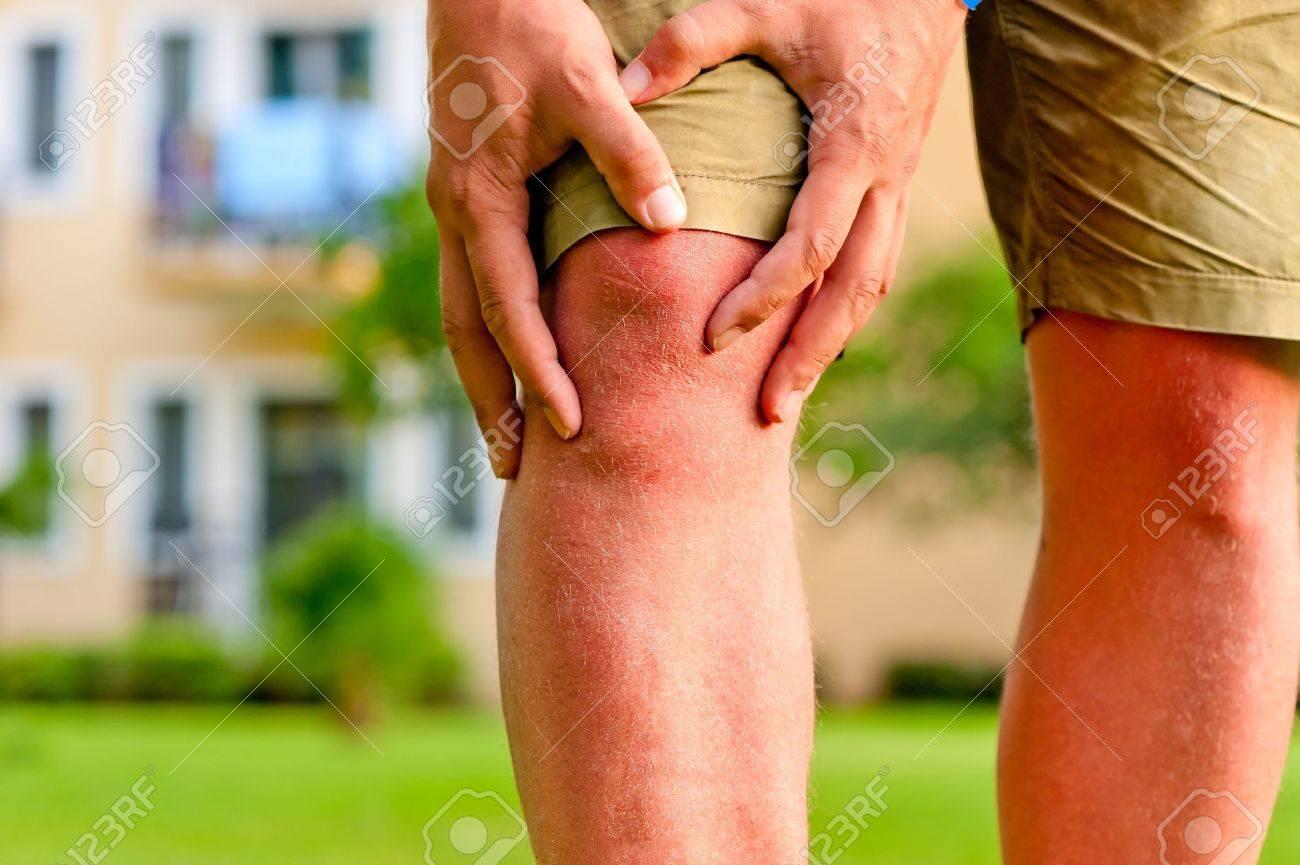 man holding hands sore knee Stock Photo - 20871212