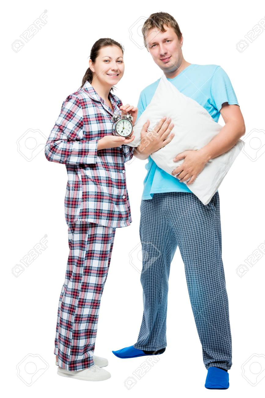 5b187aaba6 Husband and wife in pajamas on white background posing in studio Stock  Photo - 81430278