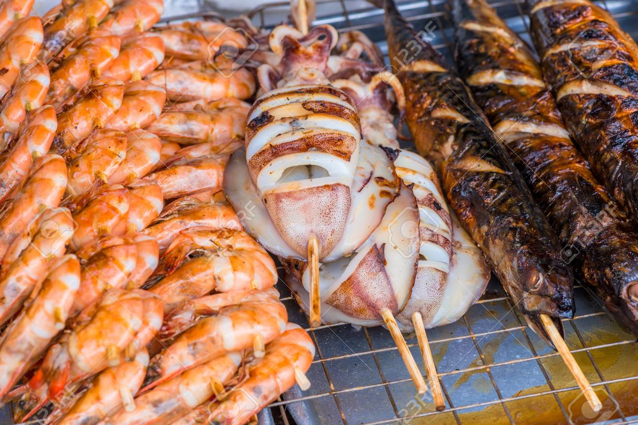 marine life cooked on the grill, close-up photo - Asian food on the street - 88909299