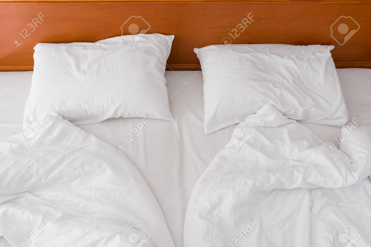 Two Pillows And A Crumpled Bed In The Hotel View From Above Stock