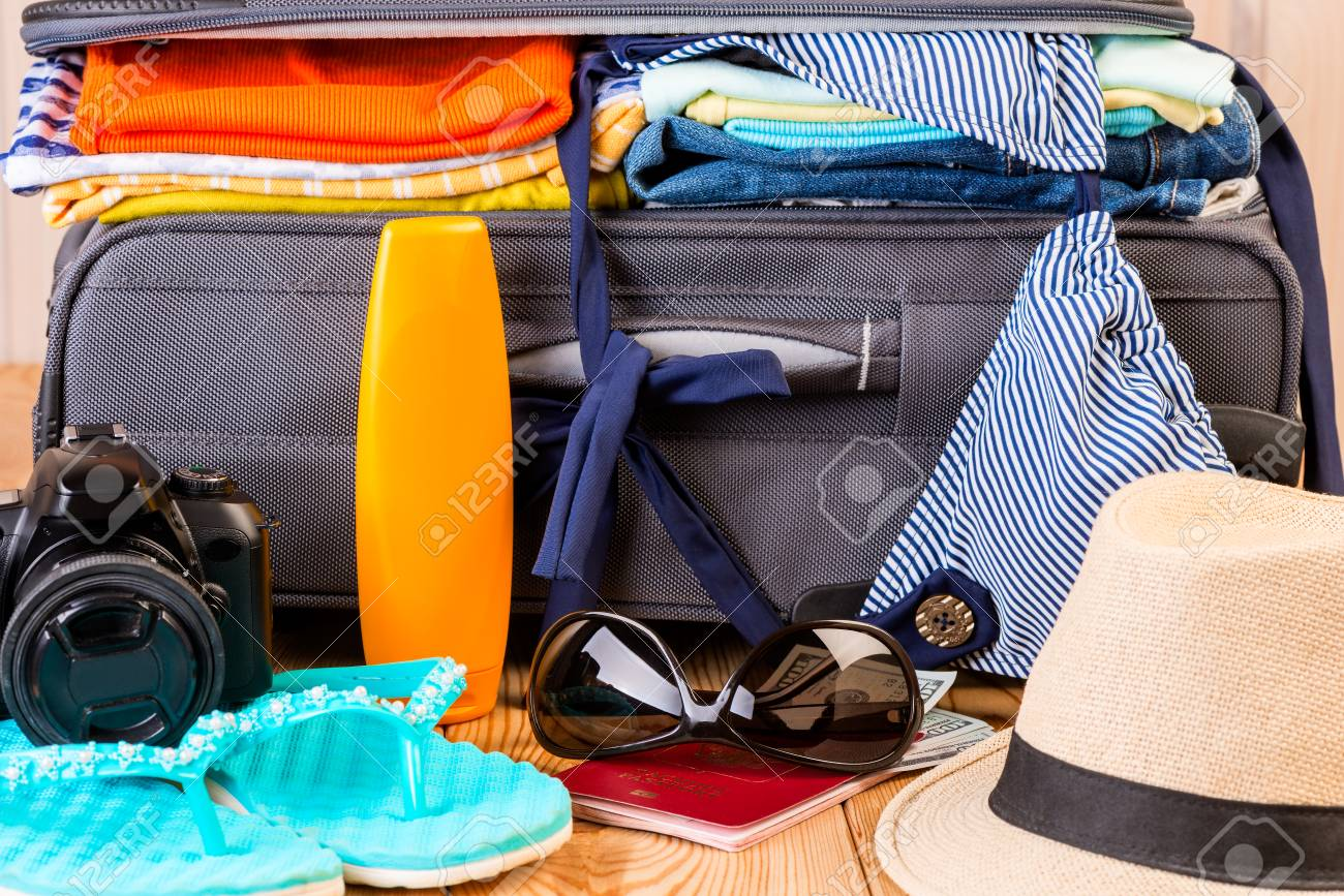 Stock Photo - summer stylish women s things for a vacation at sea on a  suitcase background 0b9913ab9e421