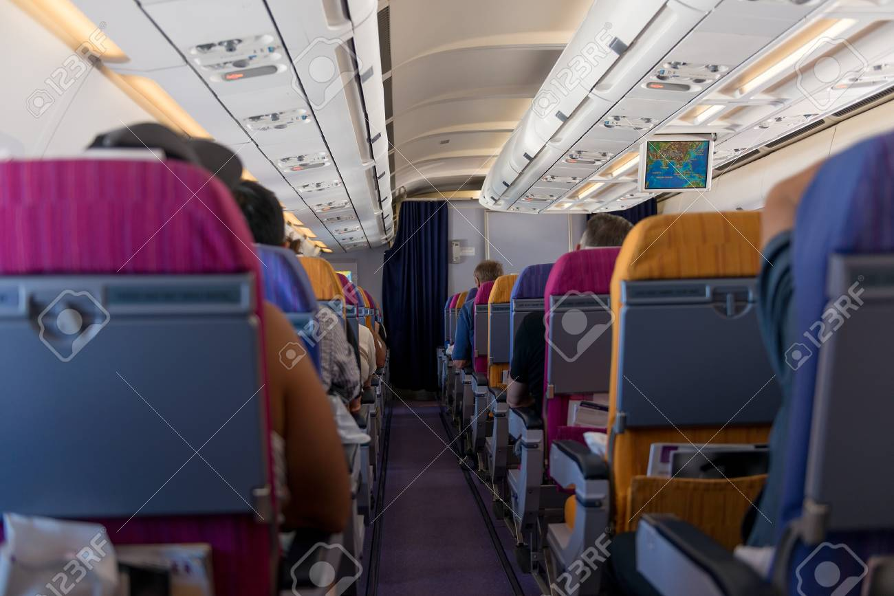 Chairs With Seated Passengers On Board The Aircraft Stock Photo   94663449