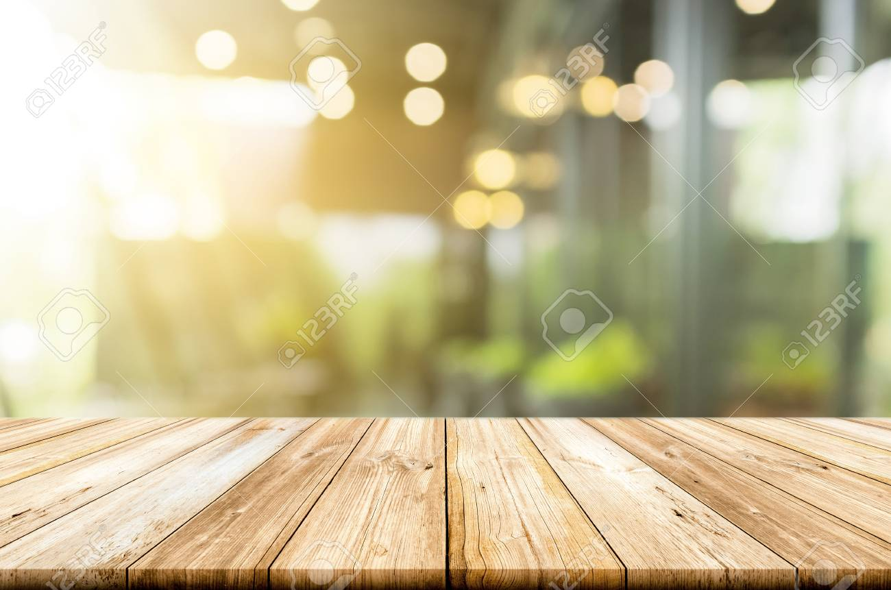 Empty Light Wood Table Top With Blurred In Coffee Shop Background. Can Be  Used For